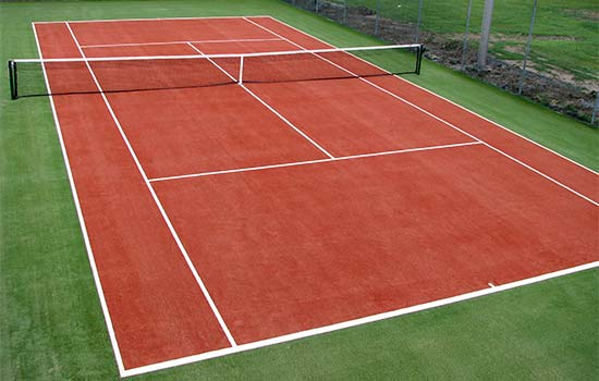 Gazon synth tique tennis carpell surfaces for Surface terrain de tennis